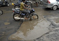 RTC Crossroads – Look for Road in Potholes, Not Potholes in Road